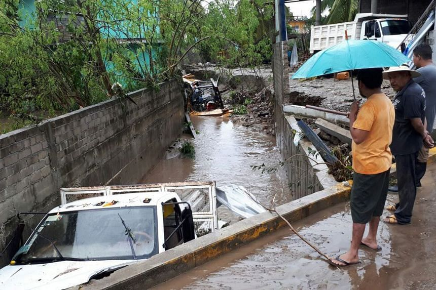 Vehicles were swept into a flooded area by Hurricane Max which <ID1>barrelled <WC1>into <WC>the Mexican town of San Marcos, Guerrero, on Thursday.