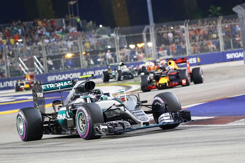 Mercedes driver Nico Rosberg in action at the F1 Singapore Grand Prix last September, when he won in Singapore for the first time. The Grand Prix is a three-day mega event with festivities ranging from concerts featuring international artists to Mich