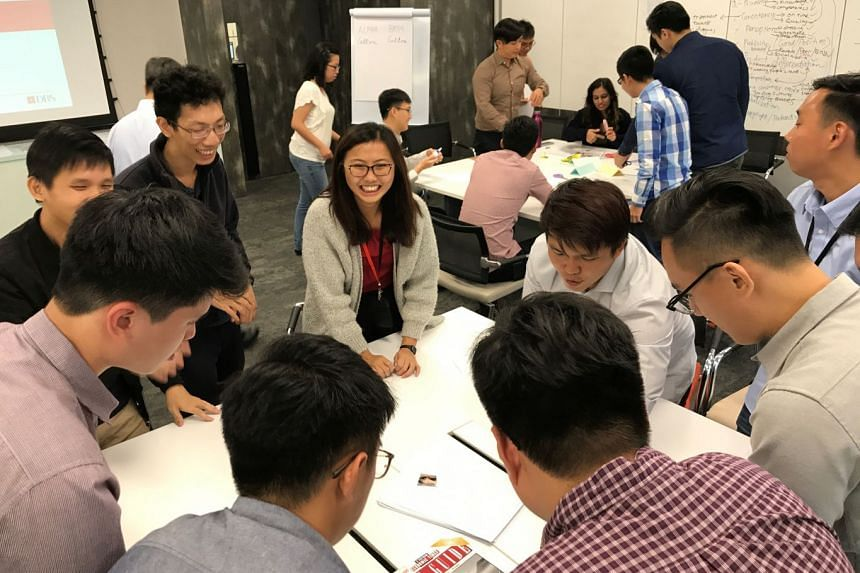 DBS' Seed Programme participants attending a workshop in the first weeks of training. Under the programme, new degree and diploma holders join the bank's technology and operations department to get on-the-job training.