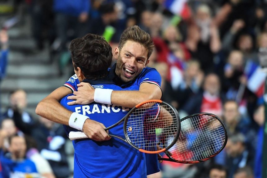 Mahut celebrates with Herbert after winning their Davis Cup semi-final tennis match against Serbia.