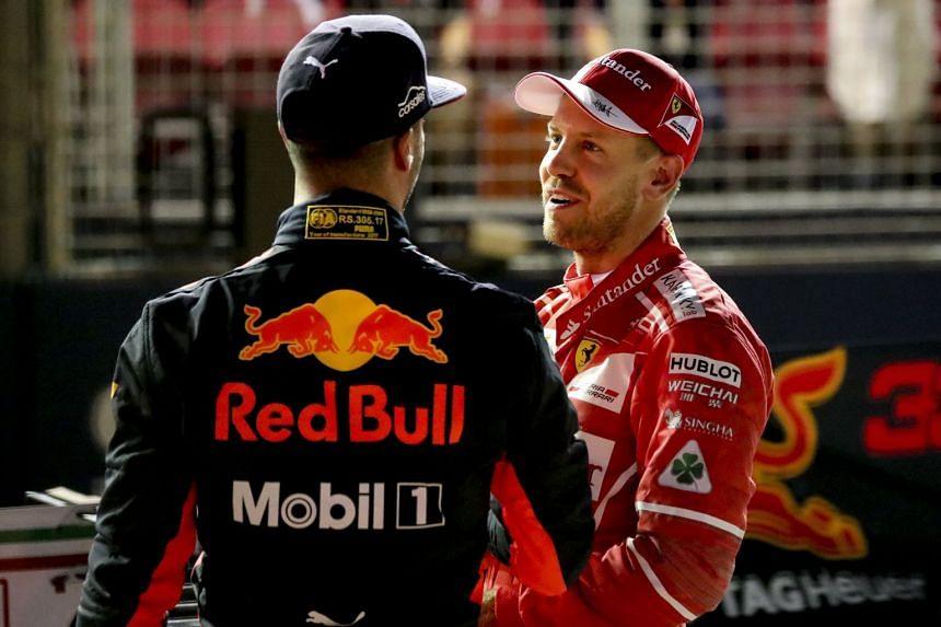Vettel (right) and Australian driver Daniel Ricciardo shake hands at the end of qualifying.