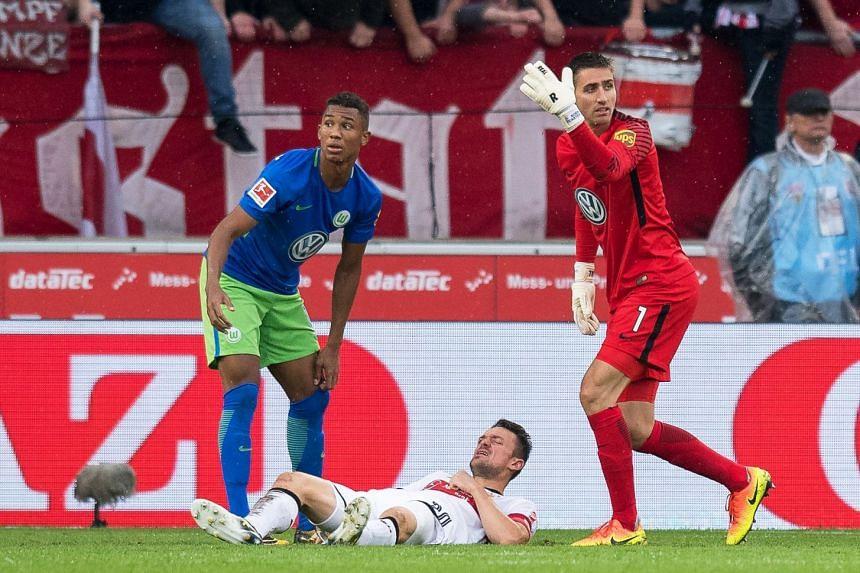 Stuttgart's Christian Gentner lies on the pitch after being injured, Sept 16, 2017.