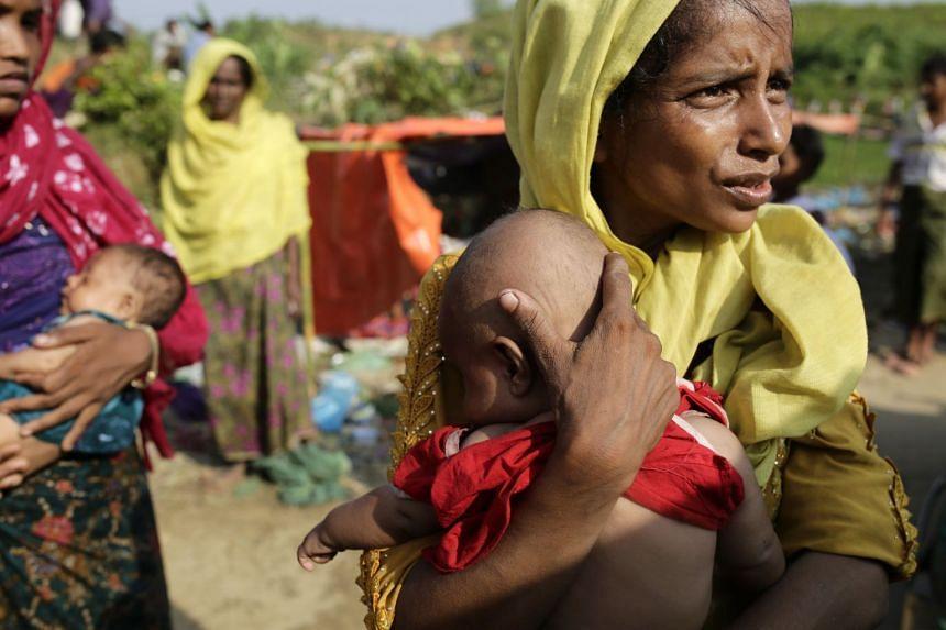 Rohingya refugees wait to collect relief at Palongkhali Bazar, Ukhiya, Bangladesh, Sept 16, 2017.