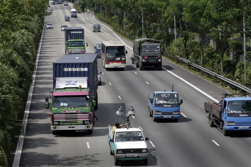 Heavy vehicles on the Pan-Island Expressway.