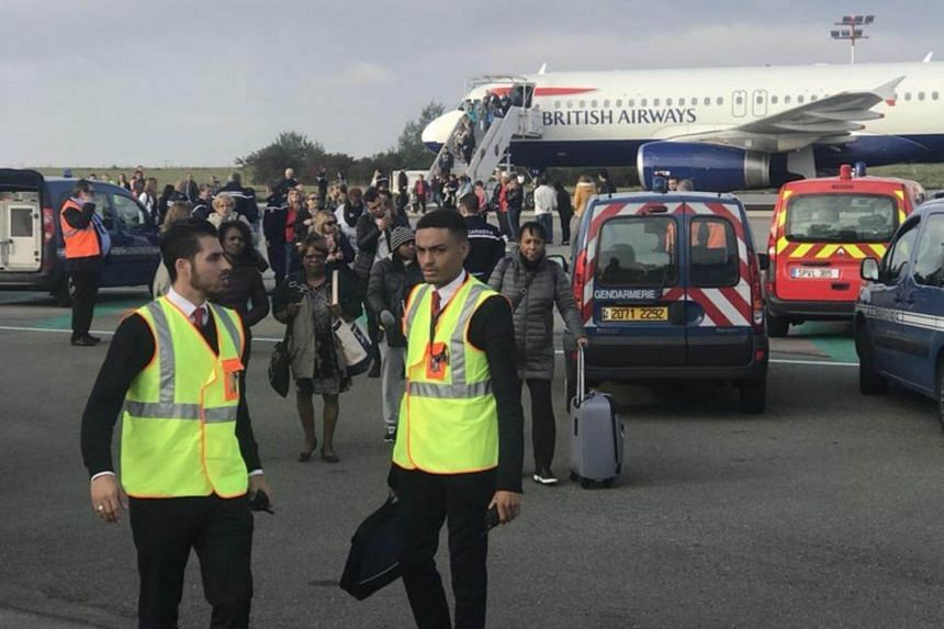 """Passengers have been evacuated from British Airways plane at Paris' Charles de Gaulle airport for a """"security reason""""."""