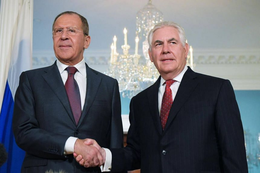 US Secretary of State Rex Tillerson shaking hands with Russian Foreign Minister Sergei Lavrov in the Treaty Room of the State Department in Washington, DC, on May 10, 2017.