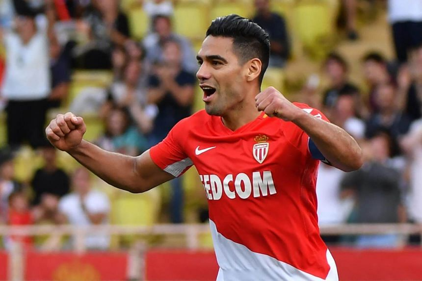 Monaco's Colombian forward Radamel Falcao celebrates after scoring his second goal during the French L1 football match Monaco (ASM) vs Strasbourg at Louis II Stadium in Monaco, on Sept 16, 2017.
