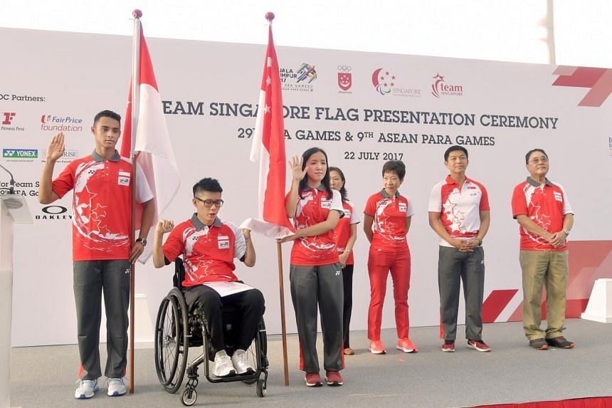 Taking the pledge at the SEA Games flag presentation ceremony were (from left) para athlete Suhairi Suhani, flag-bearer for the Asean Para Games, APG paddler Aaron Yeo and Jasmine Ser, flag-bearer for the SEA Games at the OCBC Square on July 22, 2017