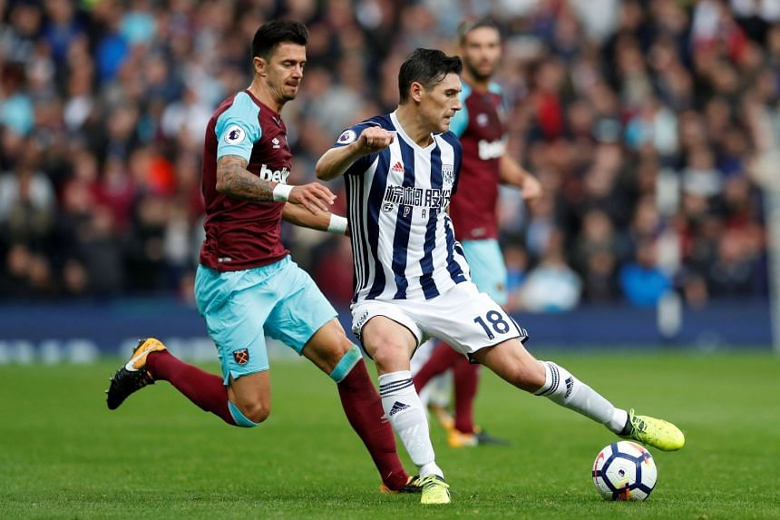 West Brom's Gareth Barry (in action, above) equalled Ryan Giggs' long standing record of 632 Premier League appearances.
