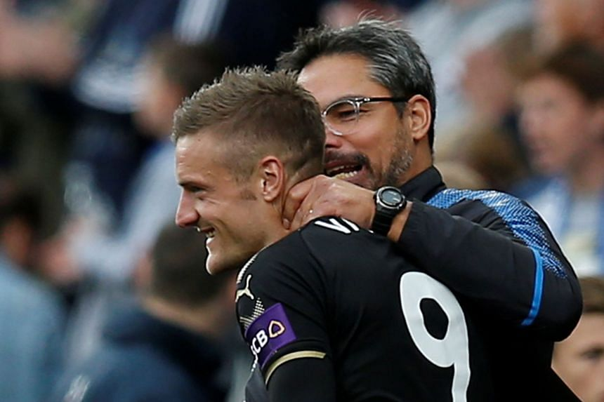 Huddersfield Town manager David Wagner embraces Leicester City's Jamie Vardy after the match.