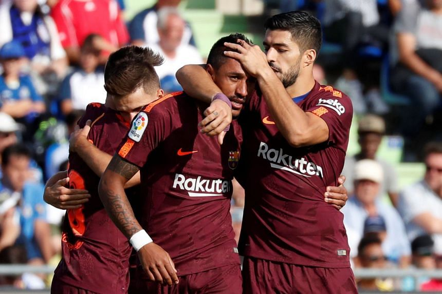 Barcelona's Paulinho celebrates scoring their second goal with Luis Suarez and teammates.