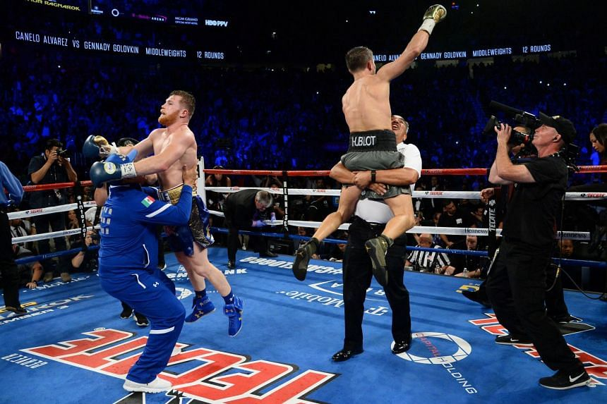 Gennady Golovkin (green trunks) and Canelo Alvarez celebrating after their world middleweight boxing championship fight at T-Mobile Arena in Las Vegas on Sept 16, 2017. The bout ended in a draw.