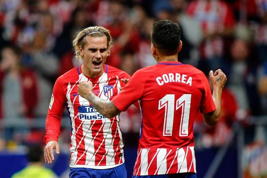 Antoine Griezmann (left) celebrates with Angel Correa (right) after scoring during the Spanish league football match at the Wanda Metropolitano stadium in Madrid, on Sept 16, 2017.
