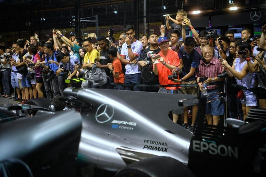 Fans watching the Mercedes pit crew in action during the Pit Lane Experience on Sept 14, 2017.