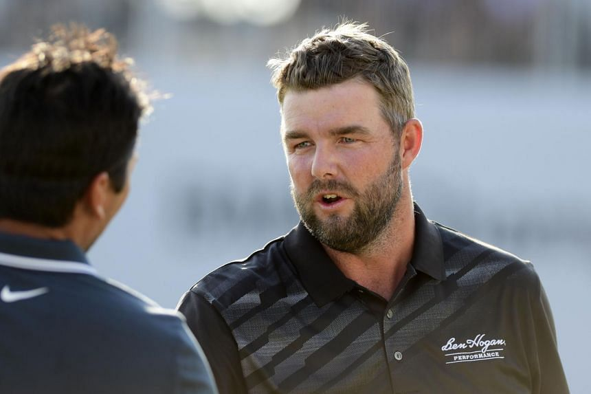 Marc Leishman (right) shakes hands with Jason Day on the 18th green during the third round of the BMW Championship.