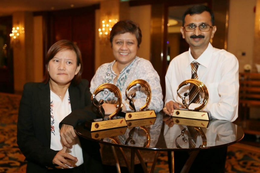(From left) Ms Oh Siew May, Ms Gemma Angela Fernandez and Atul Ramesh Deshpande received the annual Silent Heroes Award on Sunday (Sept 17) at the Shangri-La Hotel for their contributions to society.