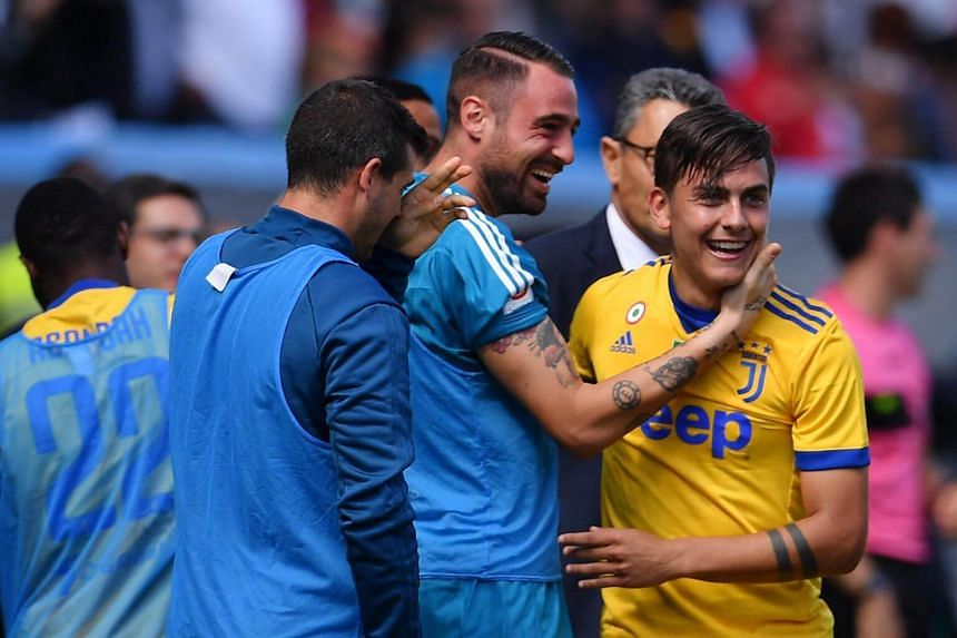 Juventus' Argentinian forward Paulo Dybala (right) celebrating with team-mates after scoring during the Italian Serie A football match against Sassuolo at the Mapei Stadium in Reggio Emilia, on Sept 17, 2017.