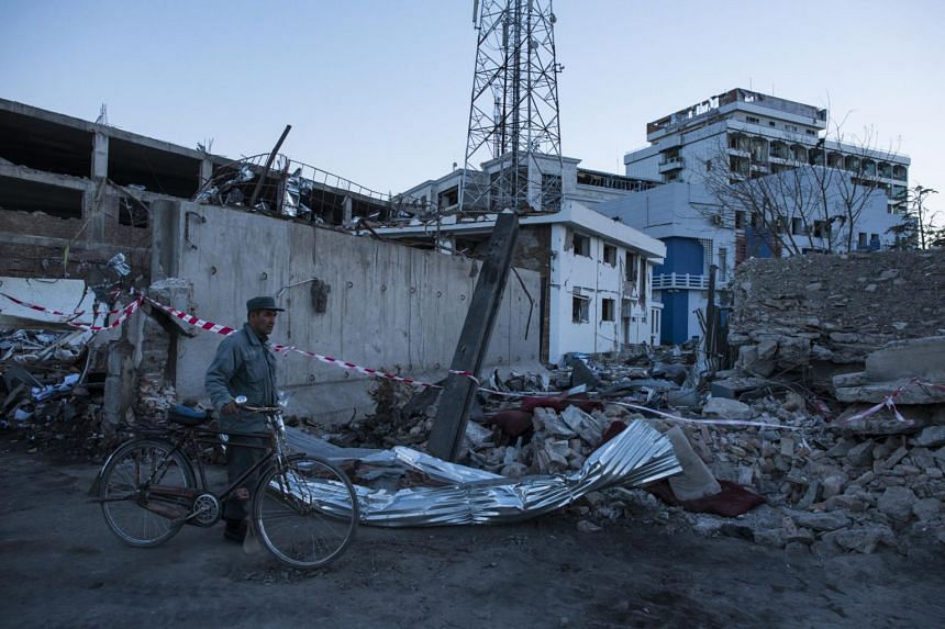 An Afghan police officer surveyed the damage from a truck bomb near several embassies in Kabul, Afghanistan, on May 31, 2017.