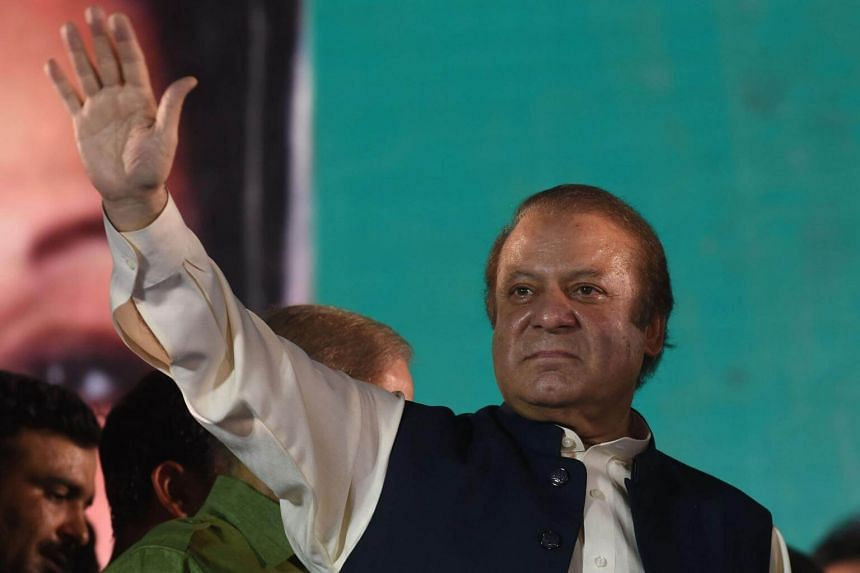 Ousted Pakistani Prime Minister Nawaz Sharif gestures as he addresses supporters at a rally after reaching his home city of Lahore on Aug 12, 2017.