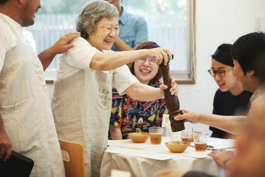 A dementia patient serves guests during the first pop-up run of the Restaurant Of Order Mistakes in June. The concept returned for a second run this weekend.