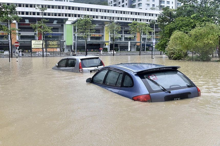 Rising waters reaching almost two metres affected more than 100 homes in Penang on Friday, and brought the morning rush hour traffic to a standstill as all main routes to the central business district in George Town were cut off. Firemen struggled to