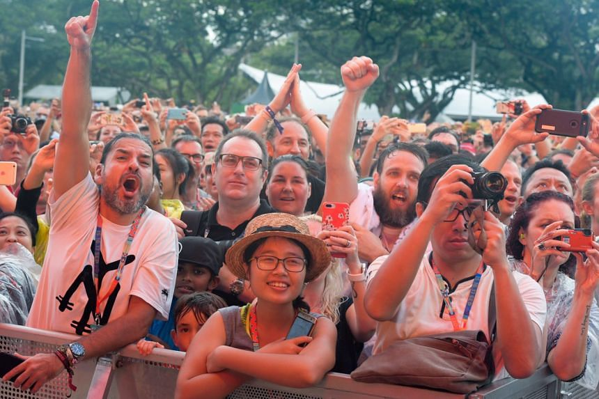 Fans watching and singing along during the Duran Duran concert at the Padang stage on Sept 17, 2017.