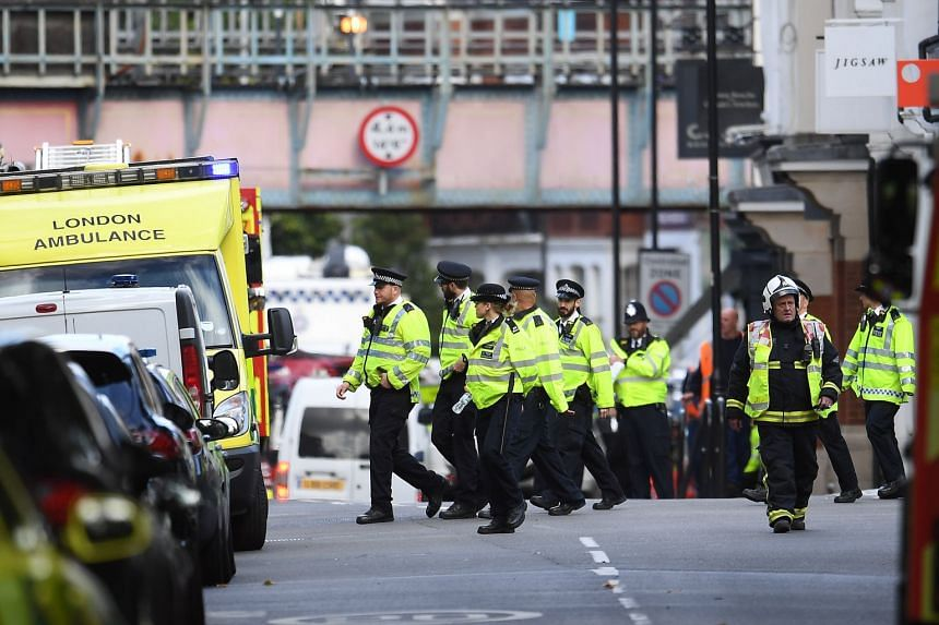 Police and fire services officers gathering near Parsons Green Underground station after a bomb exploded on board a train, in London on Sept 15, 2017.