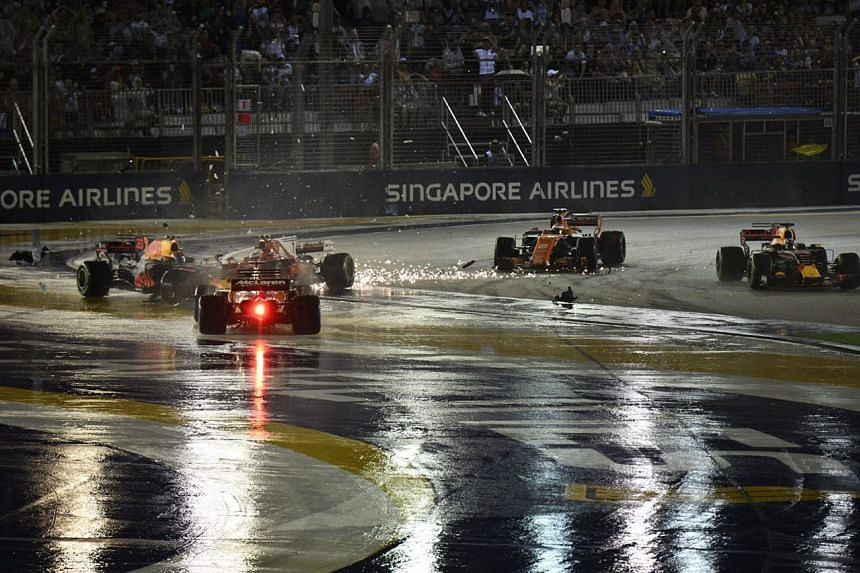 The crash as seen from Turn 3 of the 2017 Formula One Singapore Grand Prix.