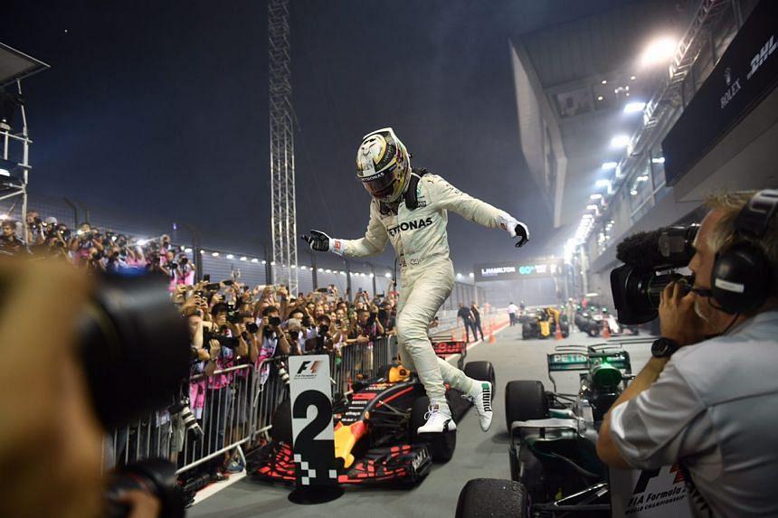Mercedes' Lewis Hamilton celebrating after winning the 2017 Formula One Singapore Grand Prix on Sunday (Sept 17).