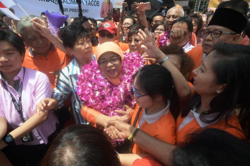 Halimah Yacob greets supporters on Nomination Day at PA HQ on Sept 13. 2017