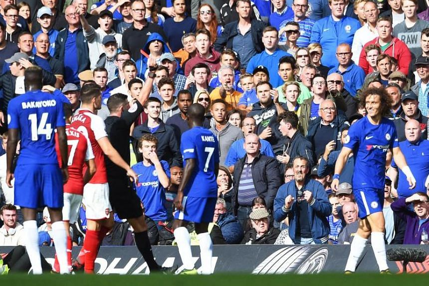 10-man Chelsea had David Luiz sent off in the 87th minute as Arsenal held the Blues to a 0-0 away draw.