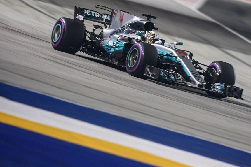 Hamilton negotiates turn 1 during the qualifying round.