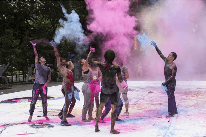 Mark by Daniel Kok ends in a riot of colours as the performers toss coloured powder in the air at the Singapore International Festival of Arts 2017.