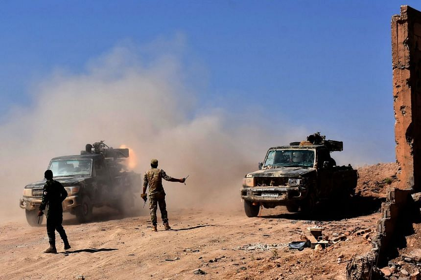 Syrian forces begin an advance against ISIS in Bughayliyah, on the northern outskirts of Deir Ezzor, Sept 13, 2017.