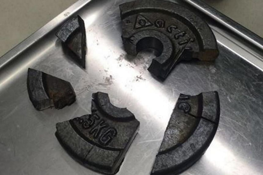 The gym weight plate was broken into five pieces, after firefighters used power tools to free the man from it.