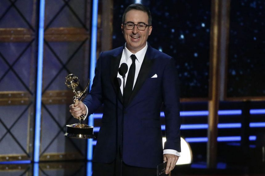 John Oliver accepts the award for Outstanding Writing for a Variety Series for Last Week Tonight With John Oliver.