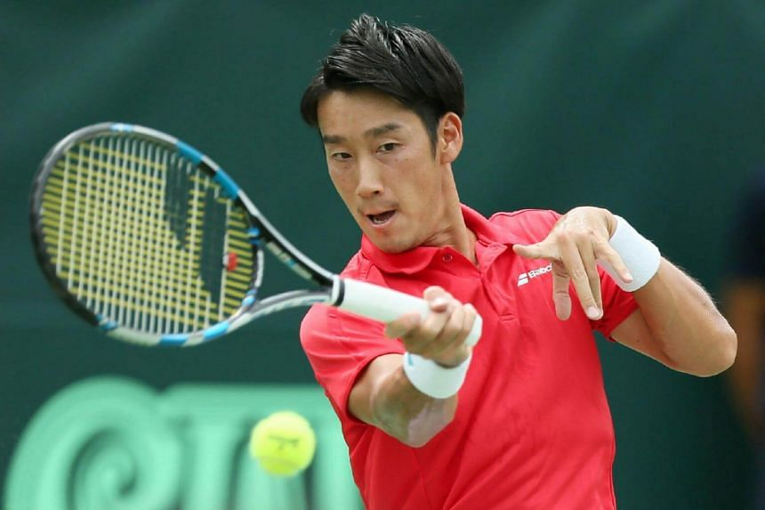 Yuichi Sugita of Japan returns the ball to Guilherme Clezar of Brazil during the first tennis match of Davis Cup World Group playoff in Osaka on Sept 15, 2017.