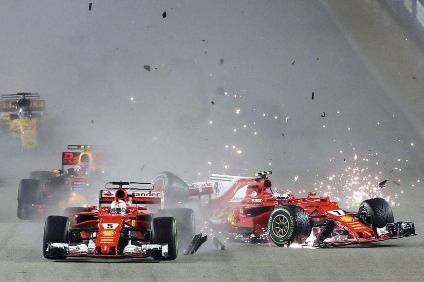 German Formula One driver Sebastian Vettel (left) of Scuderia Ferrari and Finnish teammate Formula One driver Kimi Raikkonen collide at the start of the Singapore Formula One Grand Prix at the Marina Bay Street Circuit in Singapore, on Sept 17, 2017.