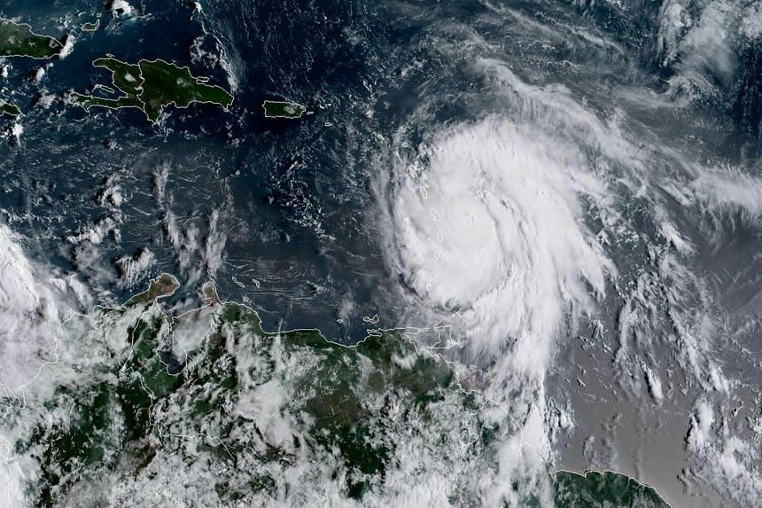 """Hurricane Maria could produce """"a dangerous storm surge"""" along with """"large and destructive waves"""" across the eastern Caribbean."""