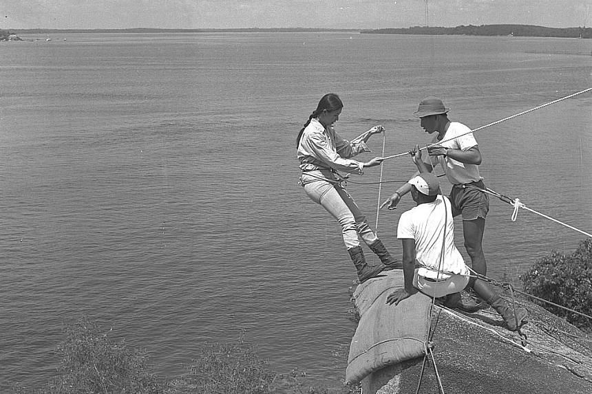 A group of female participants at a three-week course on Pulau Ubin in 1969. The group, which included students, mothers and members of the armed forces, took part in confidence course activities like scaling a 3m-high wall.