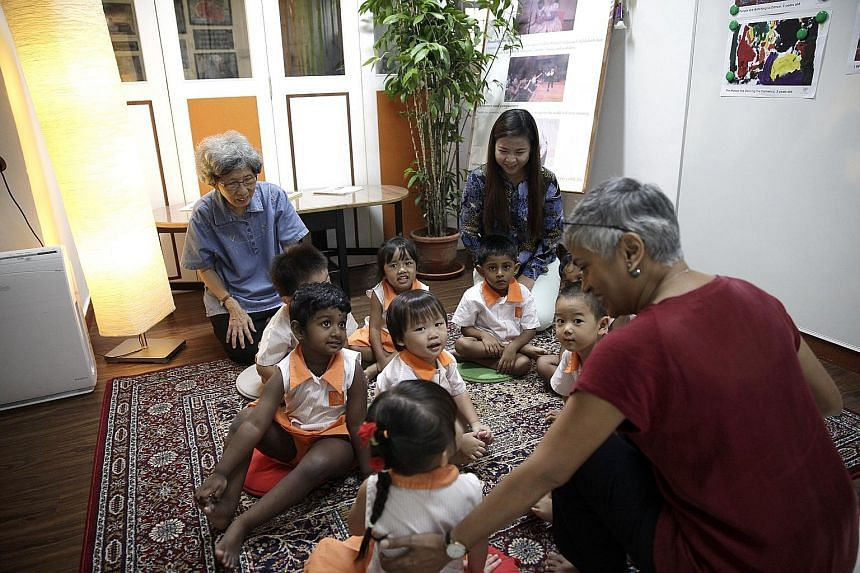 The children focus their attention on Ms Rosemarie Somaiah from the Asian Storytelling Network. Child At Street 11 is named after its location in Ang Mo Kio Street 11 and nearly seven in 10 of its 50-plus children are from low-income families. Pupils