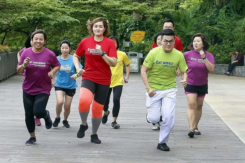 Khoo Teck Puat Hospital staff nurse Liew Han Ming (in green) and other KTPH staff taking part in a 2.4km run in a fitness challenge earlier this month. Mr Liew says exercising at his workplace helped him lose weight. Chicken with brown rice - the def