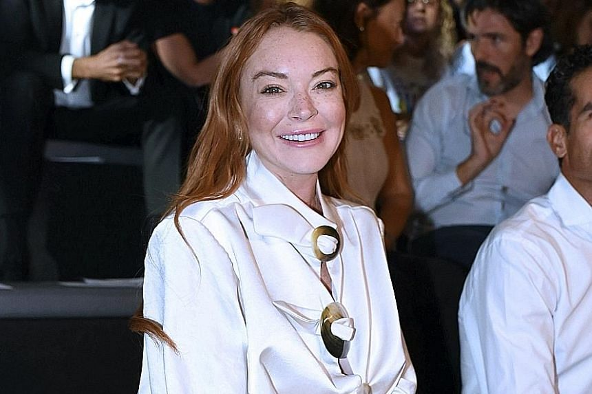 """Actress Lindsay Lohan (above) and reality star Nicole """"Snooki"""" Polizzi are among the 21 celebrities who have been asked to reveal if they are being paid to endorse products on Instagram."""