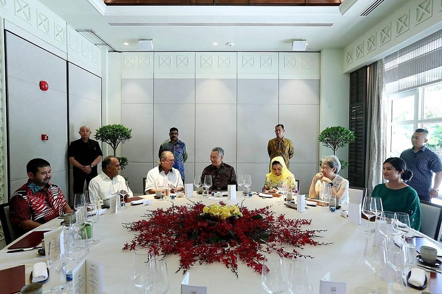 Prime Minister Lee Hsien Loong hosted the Sultan of Johor, Sultan Ibrahim Sultan Iskandar (third from left), and his family to lunch yesterday at the Shangri-La Hotel. With them were (from left) Crown Prince Tunku Ismail Sultan Ibrahim, Law and Home
