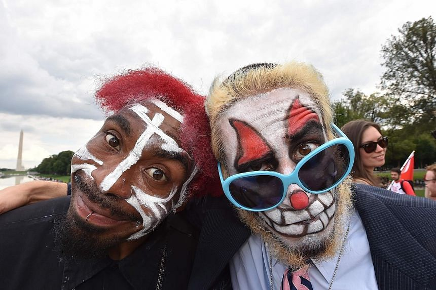 American rap group Insane Clown Posse's fans (above) protesting last Saturday in Washington against the Federal Bureau of Investigation's 2011 decision to classify them as gang members. The group was founded in 1989 by duo Violent J (Joseph Bruce) and Sha