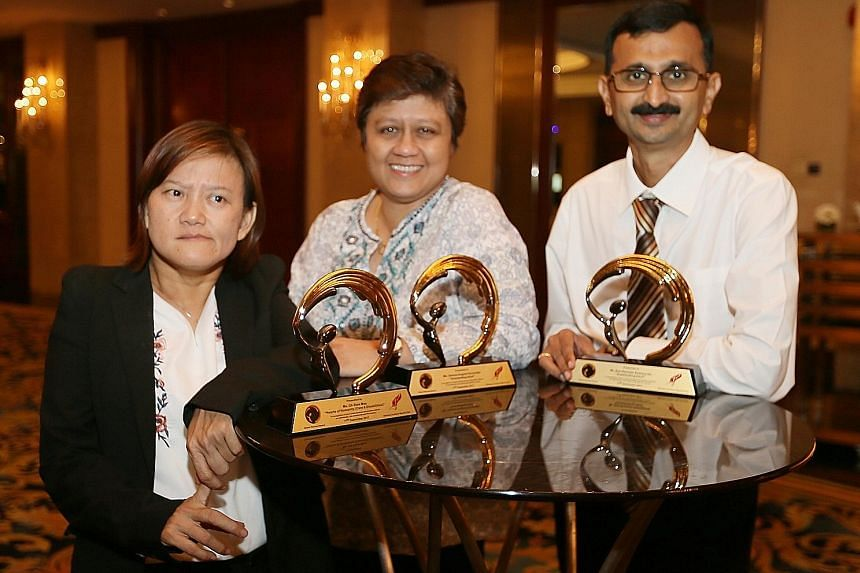 Silent Heroes Award recipients Oh Siew May, Gemma Angela Fernandez and Atul Ramesh Deshpande after the ceremony at Shangri-La Hotel last night. They were lauded for their contributions to society.