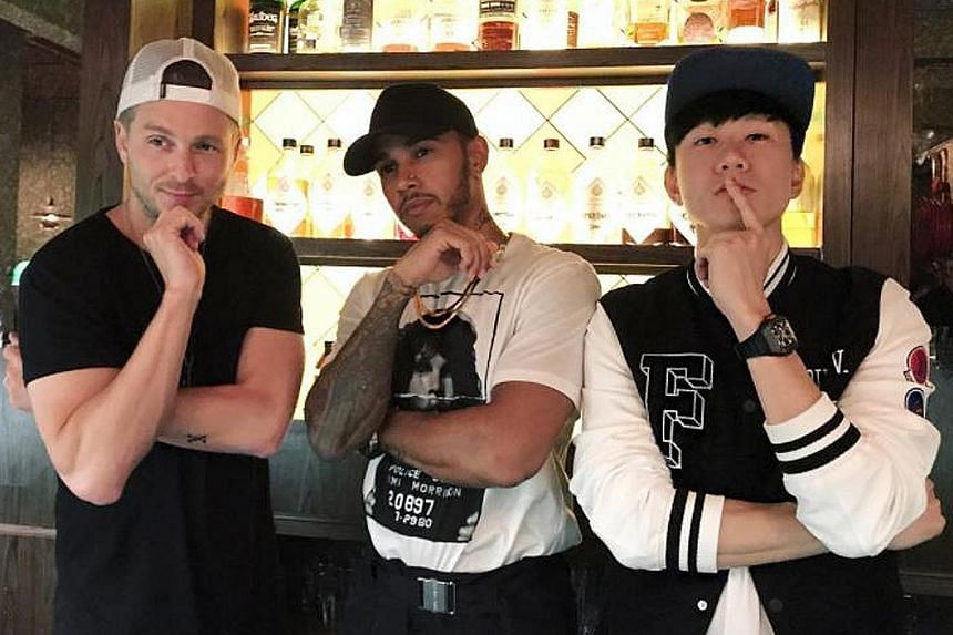 Hmmm... what would a track featuring Lewis Hamilton (centre), Ryan Tedder and JJ Lin sound like? Hanging out with the singers at Gibson Cocktail Bar should help the Mercedes driver ignite his music career.