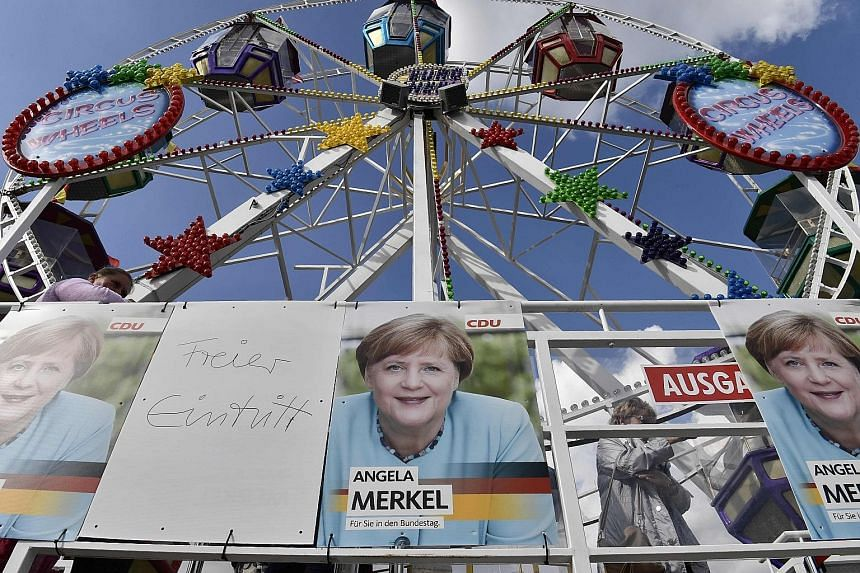 Posters of Chancellor Angela Merkel are seen in the German town of Stralsund as she continued on her campaign trail ahead of elections next Sunday. Despite her seeming popularity, her rallies have been plagued by protesters.