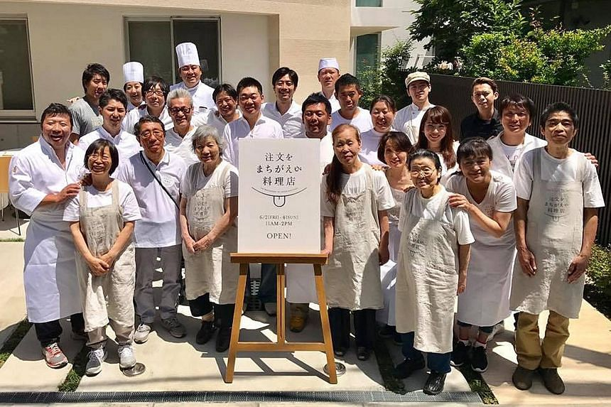 Organisers and wait staff at the first run of the Restaurant Of Order Mistakes in Tokyo in June. The idea behind the concept of the restaurant is to foster a spirit of tolerance, empathy and acceptance towards dementia patients.