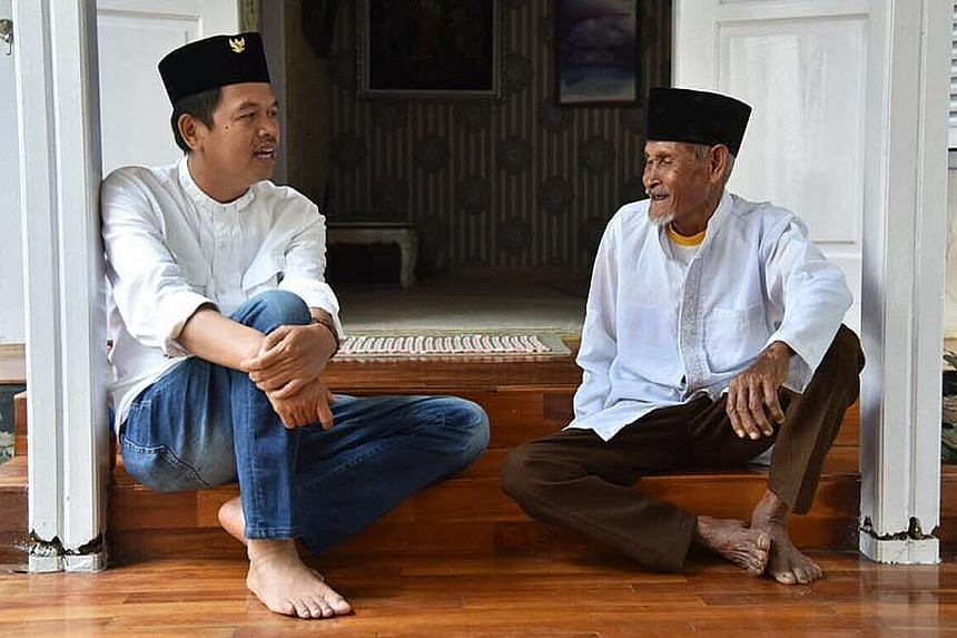 Purwakarta regent Dedi Mulyadi (left) with a local resident. Eager to put Indonesia back on track as a pluralist nation, he has won the support of its two largest parties in his run for governor.